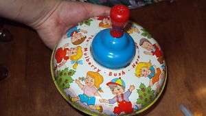 Vintage Ohio Art Spinning Tin Toy Mulberry Bush top