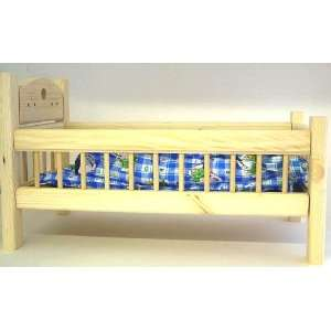 dolls bed   complete with bedding   measures approximately 26 x 44 cms