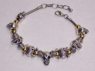 SILVER AND GOLD TONE SKULL BEAD SNAKE CHAIN CHARM BRACELET ROUND