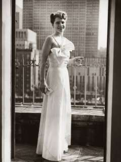 Photographer Margaret Bourke White, in Evening Dress, Standing on