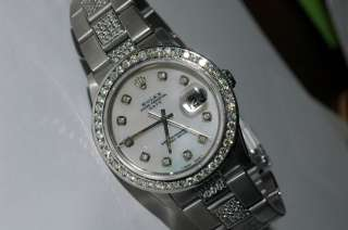 rolex oyster perpetual date with diamonds Model 15010