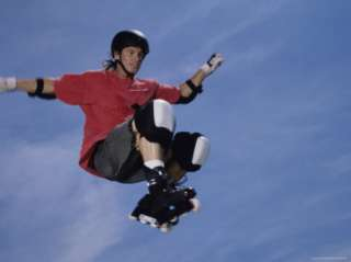 Young Man Jumping in Mid Air Wearing Inline Skates Photographic Print