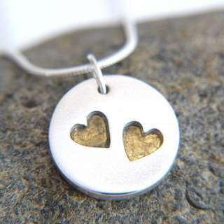 personalised wedding day silver and gold heart necklace by dizzy