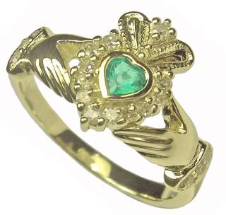 and is hallmarked set at the center is a faceted heart cut emerald